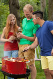 Barbecue with beer in a garden Stock Images