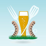 Barbecue beer. Grilled sausages on forks Stock Photos