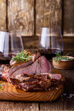 Barbecue bone ribeye steak on wooden board. Barbecue bone ribeye steak on cutting board ready to eat, delisious dinner with wine Royalty Free Stock Image