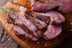 Barbecue bone ribeye steak on wooden board Stock Photography