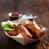 Barbecue buffalo chicken wings in container Royalty Free Stock Image
