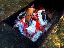 Barbecue burning firewood, coal, fire . Royalty Free Stock Photos
