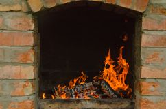 Barbecue with burning firewood. Burning fire in the fireplace, giving, rest royalty free stock images