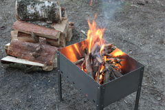 Barbecue with burning firewood Stock Image