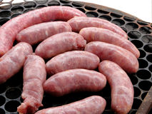 Barbecue c. Pieces of meat and sausages on a grill Stock Photos