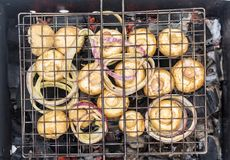 Barbecue of champignons Royalty Free Stock Photo