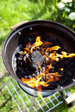 Barbecue charcoal in fire, preparing for grilling Stock Photo