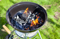 Barbecue charcoal in fire, preparing for grilling Royalty Free Stock Photography