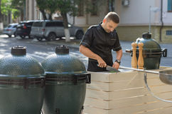 Barbecue chef tasting outdoor kitchens Stock Photos