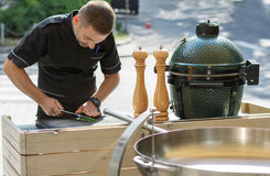 Barbecue chef tasting outdoor kitchens Royalty Free Stock Image