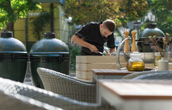 Barbecue chef tasting outdoor kitchens Stock Images