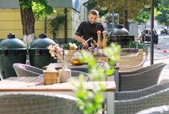 Barbecue chef tasting outdoor kitchens Royalty Free Stock Images