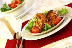 Barbecue Chicken. Grilled boneless chicken breast with bbq sauce, salad greens and tomatoes Stock Image