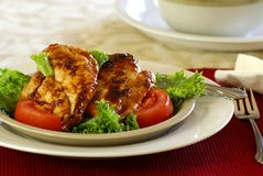 Barbecue Chicken. Grilled boneless chicken breast with bbq sauce, salad greens and tomatoes Stock Photography