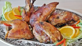 Barbecue chicken and citrus Stock Images