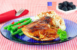 Barbecue Chicken Dinner Decorated With Flag. Stock Photo