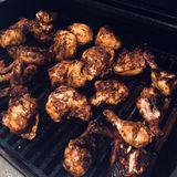 Barbecue chicken on a grill Stock Photography