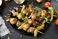 Barbecue from chicken liver, potato and bell pepper. Tasty bbq skewers Stock Image
