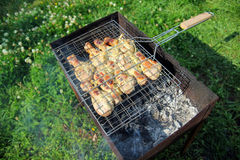 Barbecue with chicken  in metal grate Stock Photos