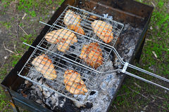 Barbecue chicken over an open fire in  summer Stock Images