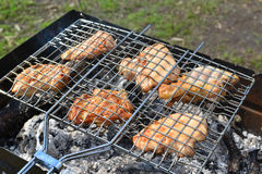 Barbecue chicken over an open fire in  summer Stock Photography