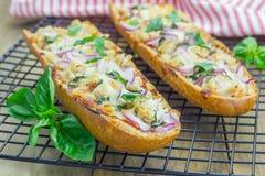 Barbecue chicken pizza baguette. Selective focus Stock Photos