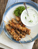 Barbecue chicken skewers with yogurt sauce. Royalty Free Stock Photo