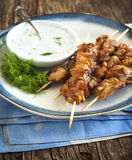 Barbecue chicken skewers with yogurt sauce. Barbecue chicken skewers with yogurt sauce served on plate Stock Photo