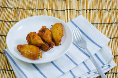 Barbecue chicken wing on white plate Royalty Free Stock Images