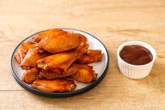 Barbecue chicken wings. With sauce stock photo