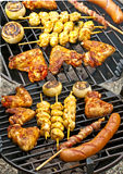 Barbecue with chicken wings Stock Photos