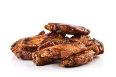 Barbecue chicken wings. Closeup of some barbecue chicken wings on a white background royalty free stock photography