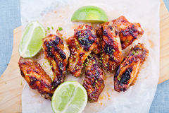 Barbecue Chicken Wings With Lime. Close up of some hot and spicy barbecue chicken wings royalty free stock images