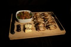Barbecue chicken wings with salad and halloumi stock photos