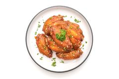 Barbecue chicken wings with white sesame. Baked barbecue chicken wings with white sesame isolated on white background stock photography