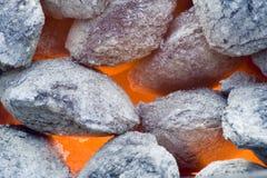 Barbecue coals. Background shot of barbecue coals alight stock images