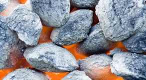 Barbecue coals. Background shot of barbecue coals alight royalty free stock photos