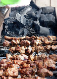 Barbecue and coals. Cook barbecue on charcoal background Stock Photography