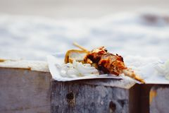 A half-eaten kebab. Barbecue cooking - half done kebab of marinated pork, onion and tomatos Stock Photos