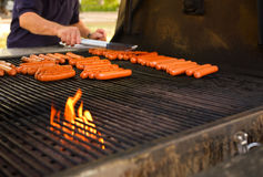 Barbecue cookout. Hot-dogs on a large barbecue outdoors(shallow dof Stock Images