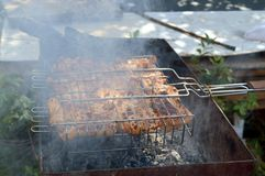 Barbecue at the cottage. Barbecue with smoke at the cottage Royalty Free Stock Photography