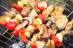 Barbecue with delicious grilled meat on grill Stock Photos