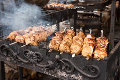 Barbecue with delicious grilled meat on grill. Beef kababs over charcoal Royalty Free Stock Photo