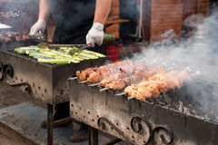 Barbecue with delicious grilled meat on grill. Beef kababs over charcoal Stock Photos