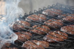 Barbecue with delicious grilled meat on grill stock images
