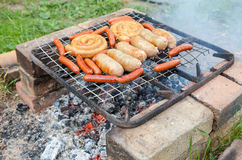 Barbecue with delicious grilled sausages Royalty Free Stock Photo