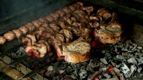Barbecue with different kinds of meat on the grill stock video footage