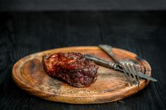 Barbecue Dry aged Ribeye Steak with knife and fork on cutting board Stock Photo