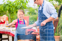 Barbecue with family in the garden Stock Photography