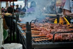 Barbecue in a fest. Cooking meal in a traditional fest Royalty Free Stock Image